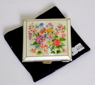 A Fine Sterling Silver and Guilloche Enamel Compact Profusely Decorated with Flowers by Henry Clifford Davis