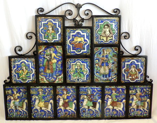 A Wrought-Iron Frame Containing Fourteen Antique Islamic Tiles. Early 1900s.