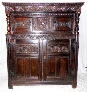 A Fine English Carved Oak Court Cupboard. Mid 17thc.