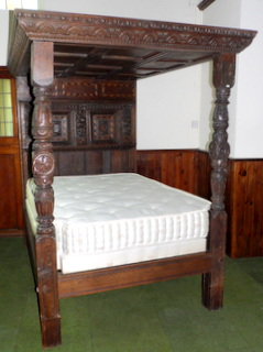 A Period Carved Oak and Chequer-Lined Tester Bed.