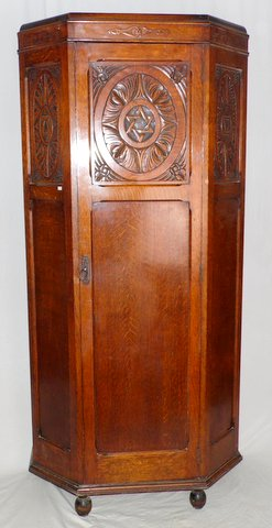 1920s Carved Oak Hall Robe.  Quality,carved top with canted moulded corners,standing on ball feet.The single door with carved panel opening to reveal hanging hooks x7,mirror and shelf.  Height 77 in.  Width 35 in.  Depth 16 in.